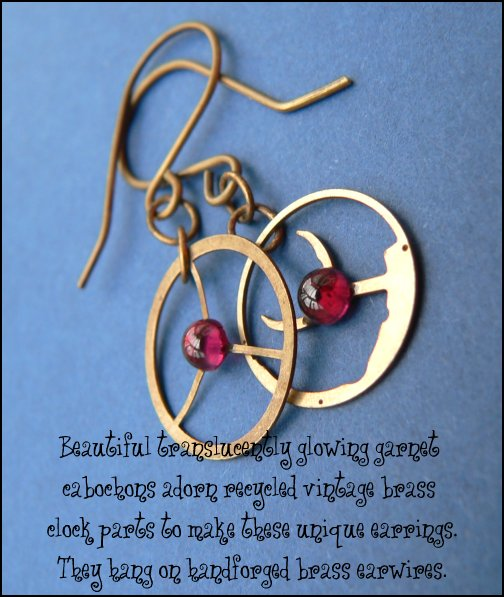 Beautiful translucently glowing garnet cabochons adorn recycled vintage brass clock parts to make these unique earrings.