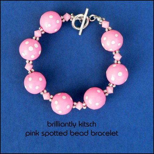 bracelet made with pink plastic spotted beads and pink plastic bicone beads, fittings are Tibetan silver