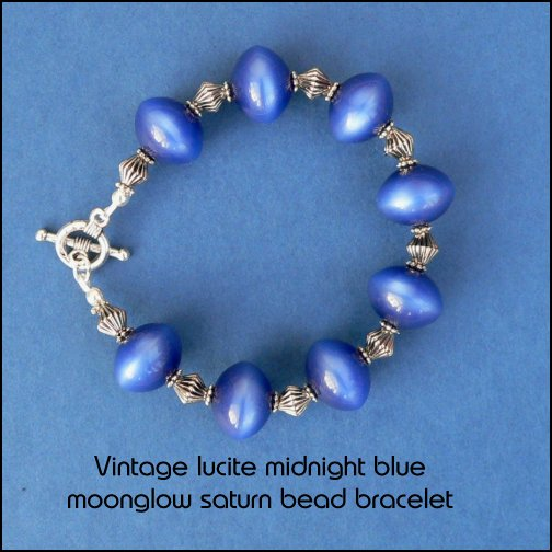 bracelet made from midnight blue vintage lucite saturn beads with tibetan silver fittings