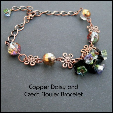 a pretty  black czech glass bell flower cluster is the centrepiece of this bracelet linked by copper daisy connectors and golden faceted czech glass beads