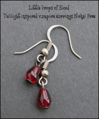 Richly glowing blood red claret glass drops trembling from silver ox earwires.