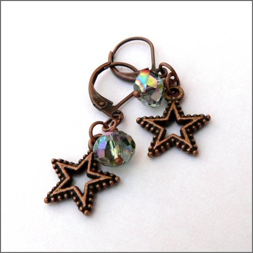 Copper effect stars ornamented with beautifully cut Czech glass rondelle beads which shine with a kind of indescribable pale pinky green colour!