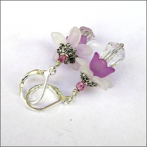 Beautifullly sparkling crystal clear glass drops adorned with orchid petals and ornamented with tibetan silver swaying under nickel free silver plated leverbacks