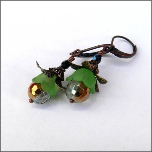 Glittering golden faceted glass beads capped with green and adorned with bronze coloured petals and copper swaying under nickel free copper leverbacks