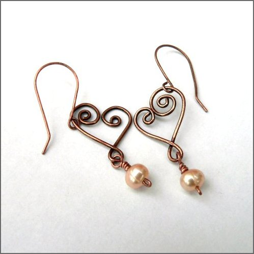 Freshwater pearl and copper heart earrings. Handforged copper hearts each embellished with a beautiful pale honey coloured freshwater pearl