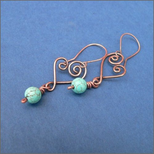 Hand-forged copper hearts each embellised with a pretty turquoise gemstone bead hanging from handmade copper earwires.